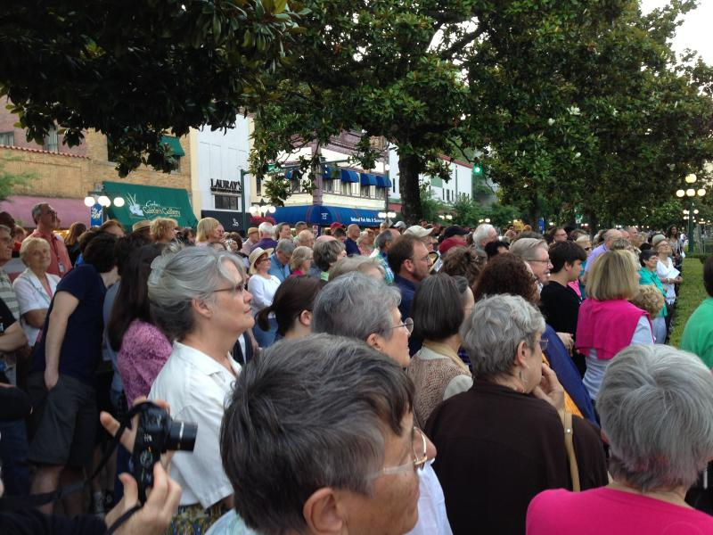 Audiences watch multiple peformances outside the Bathhouses in Hot Springs on Saturday.
