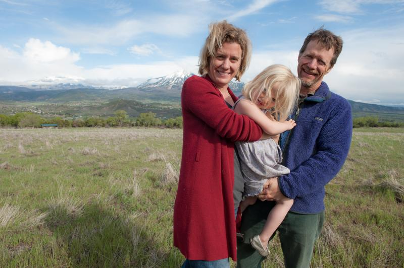 Michelle Nijhuis, Jack Perrin and daughter Sylvia on their land in Paonia, Colorado.