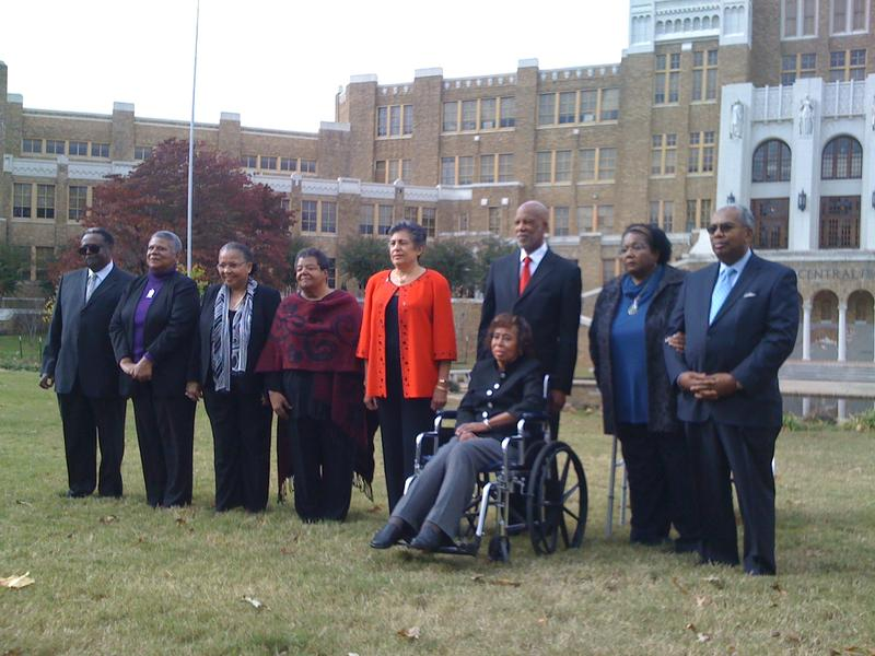 The Little Rock Nine pose in front of Little Rock's Central High School for the New Yorker magazine.
