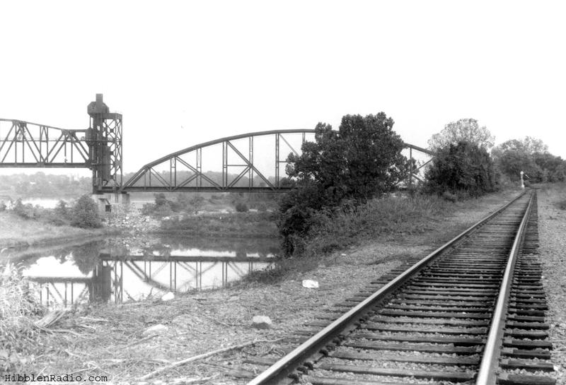 The Rock Island Bridge in 1994 when it was abandoned, with Union Pacific tracks running alongside the river.