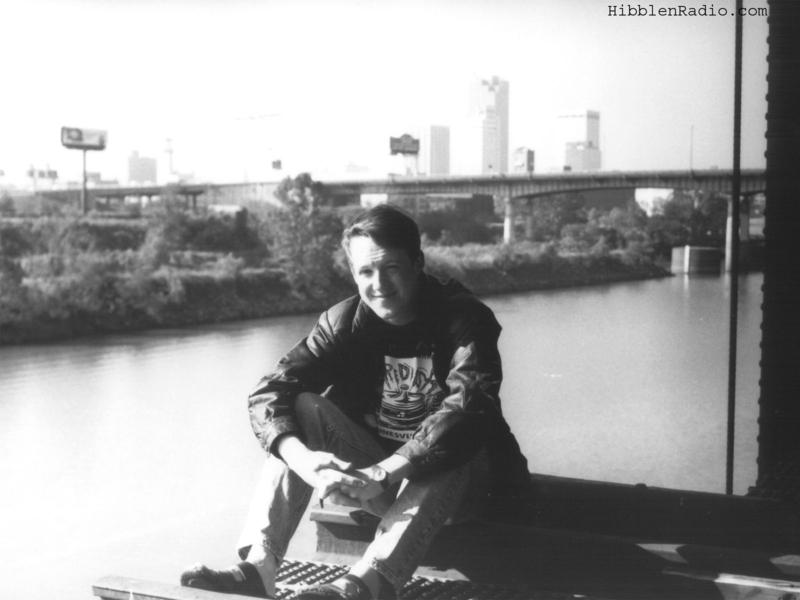 KUAR's Michael Hibblen, sitting on the edge of the opening at the lift span in 1994.
