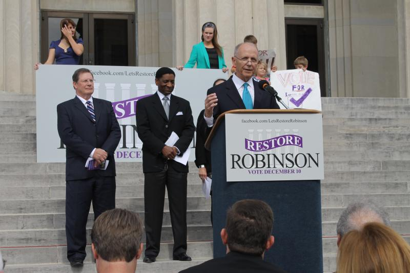 Former Little Rock Mayor Jim Dailey, a co-chair of Restore Robinson, speaks to the crowd.