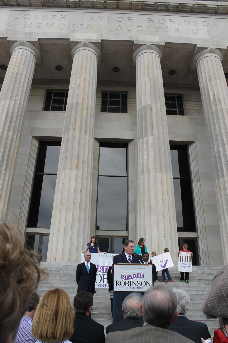 Mayor Stodola speaks in front of the historic auditorium.