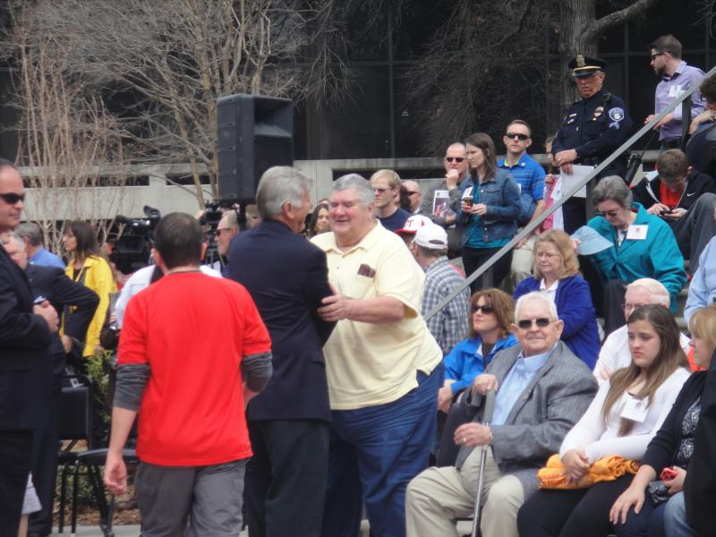 Governor of Arkansas Mike Beebe shook family member's hand.