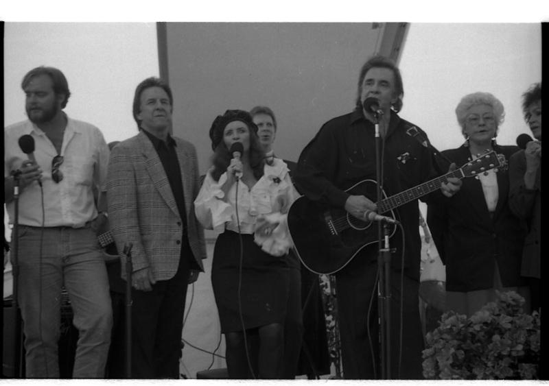 Johnny Cash playing in Kingsland, March 1994, with wife June, brother Tommy, and son John Carter Cash