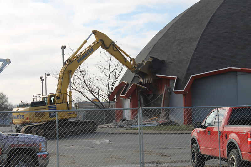 An excavator begins the demolition of the old UA Cinema 150 Tuesday.