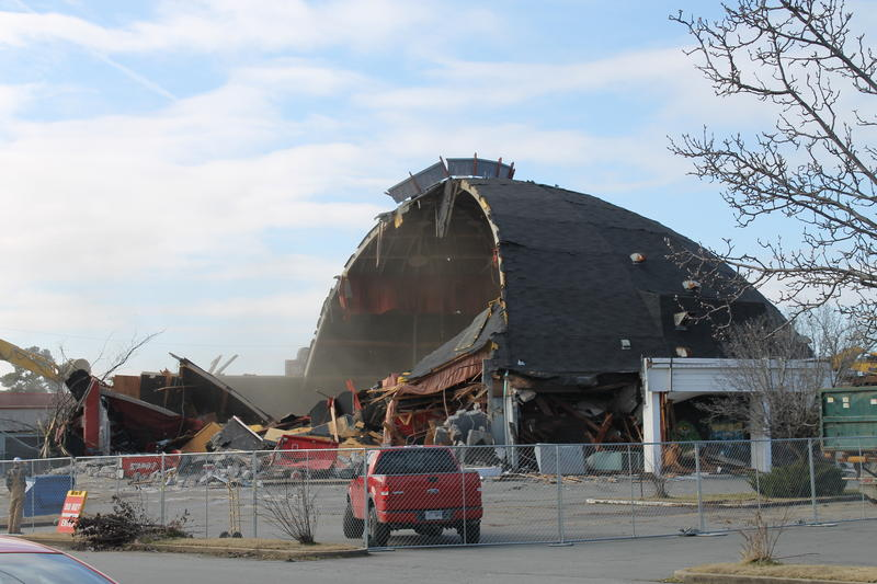 Half of the old theater collapses.