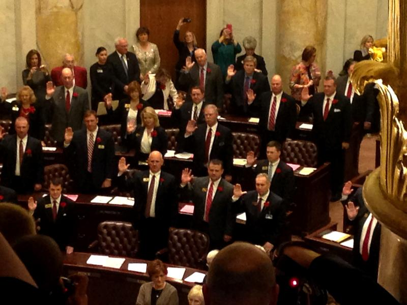 Members of the state House of Representatives being sworn in on the 90th General Assembly's opening day.