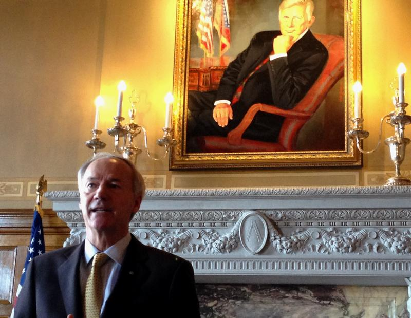 Gov. Asa Hutchinson (R) talks about why he's moving back his budget plan in the Governor's Conference Room. Former Gov. Mike Beebe's portrait hangs above Hutchinson.