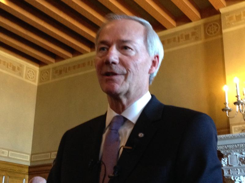 File photo: Gov. Asa Hutchinson speaking to reporters at the Capitol about his budget proposal.