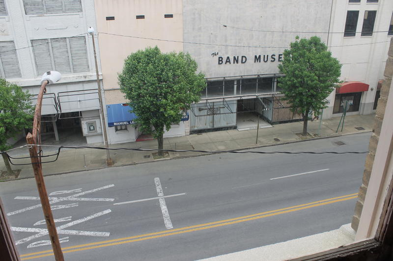 The Band Museum building, which has since collapsed, as seen from a room inside the Hotel Pines.