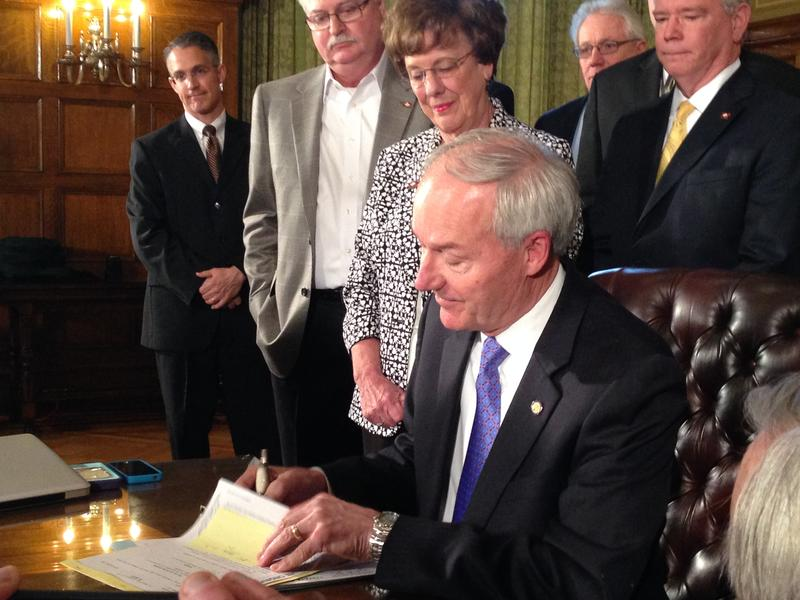 Gov. Asa Hutchinson signing a workforce development bill.