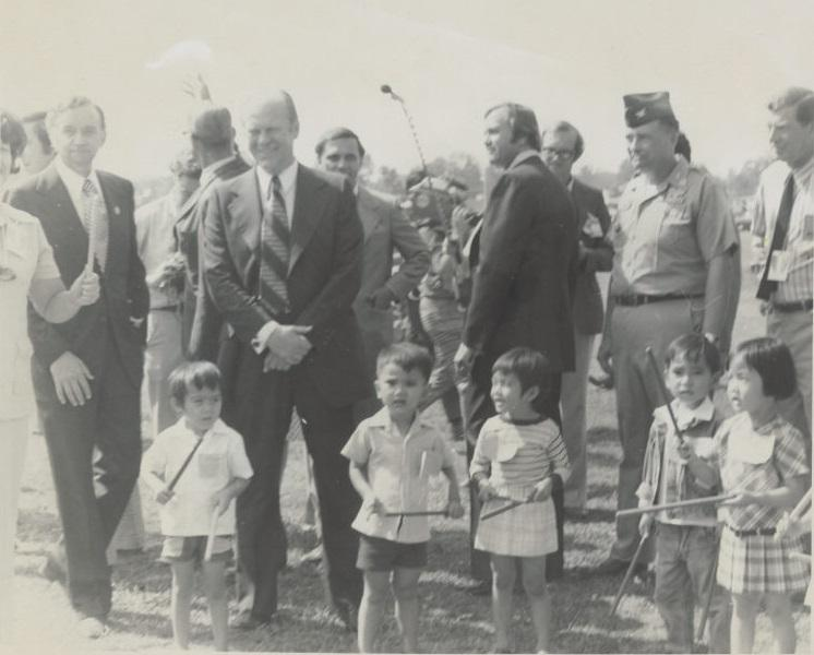 President Gerald Ford poses with refugee children at Fort Chaffee