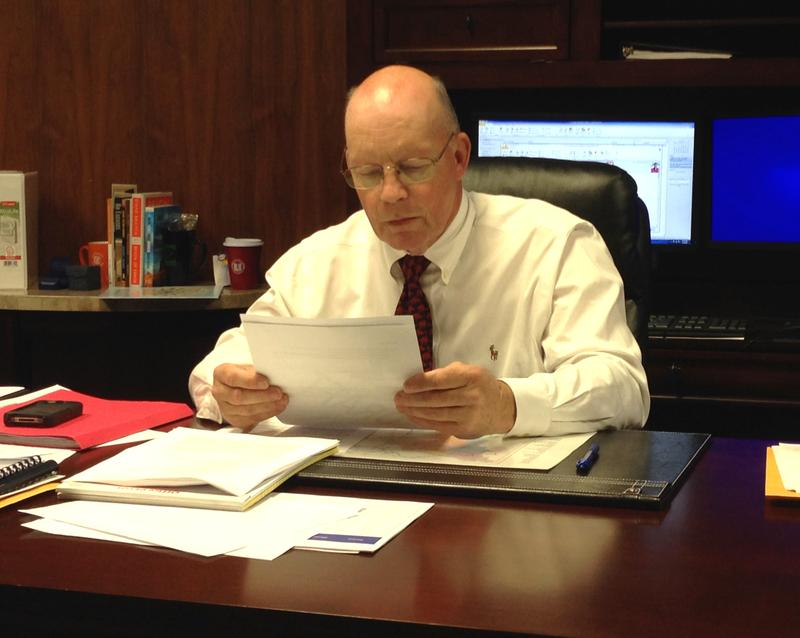 Superintendent Baker Kurrus sitting at his new desk in the LRSD administration building.