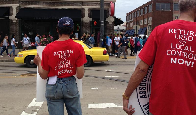 Demonstrators in downtown Little Rock looking away from the LR Regional Chamber of Commerce building.