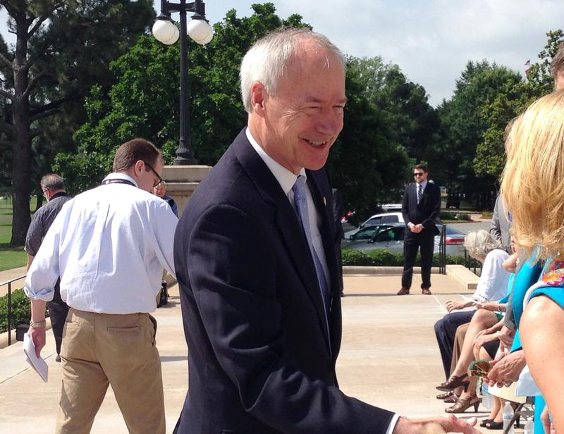 Governor Asa Hutchinson (R) on the state Capitol steps.