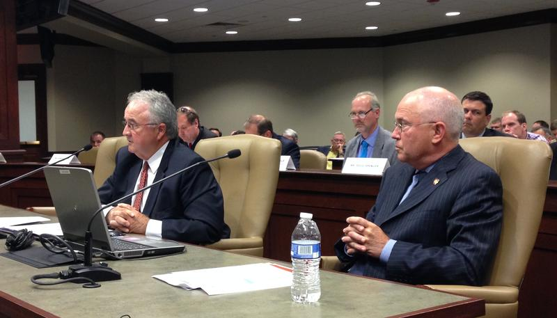 Arkansas Department of Emergency Management director David Maxwell (right) and Arkansas Natural Resources Commission executive director Randy Young (left) testify to a joint meeting of legislative committees on levees and flooding.
