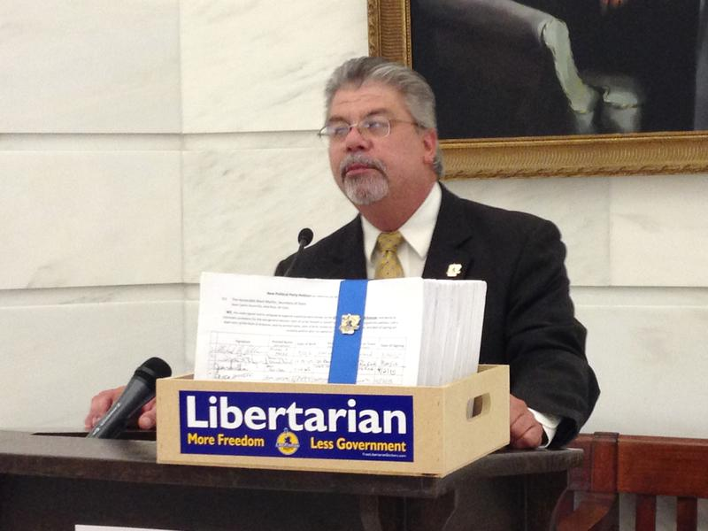 Libertarian Party of Arkansas Chair Michael Pakko with over 15,000 signatures to be submitted to the Secretary of State's office for ballot access. May 2016.