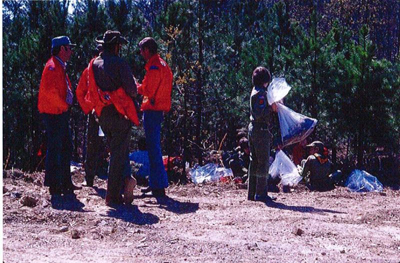 Volunteer with a bag of trash.