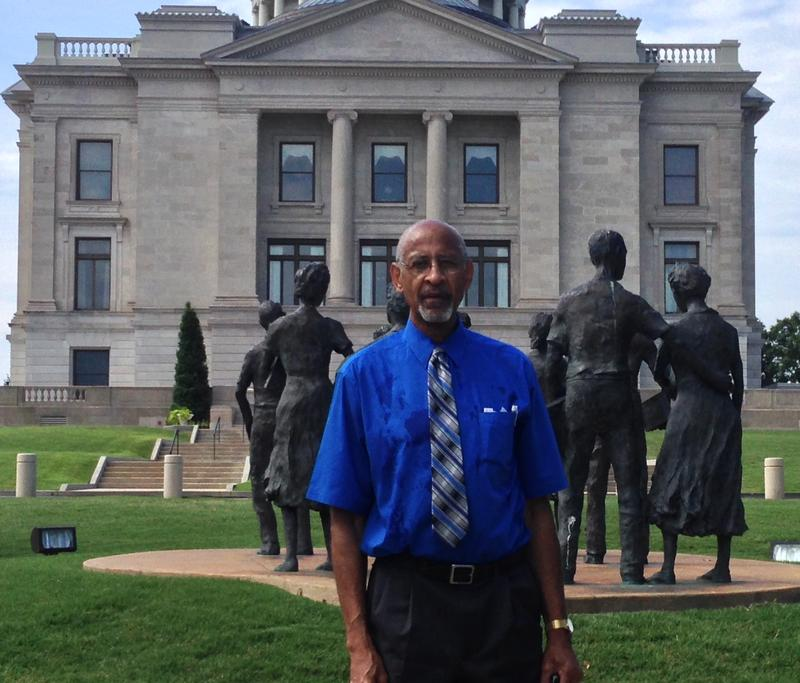 Dale Charles of Arkansas's NAACP in front of the Little Rock Nine Monument.
