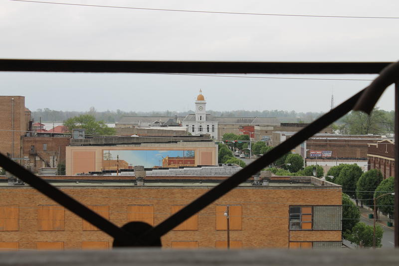 A view of the Jefferson County Courthouse in Pine Bluff from inside the historic, but crumbling Hotel Pines.