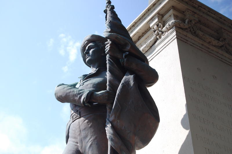 The Confederate soldiers monument has a soldier holding a Confederate battle flag.