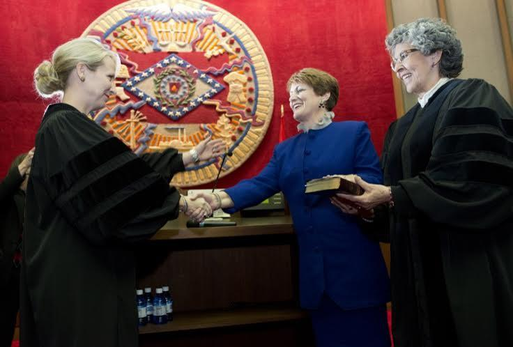 THEIR HONORS: Karen Baker (center) takes oath with Courtney Goodson (left) and Jo Hart.