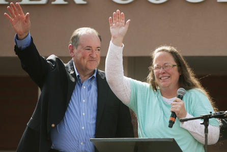 Former Arkansas Governor Mike Huckabee with Kim Davis as she exited jail following her refusal to follow a court order to issue marriage licenses to same-sex couples in Kentucky county.