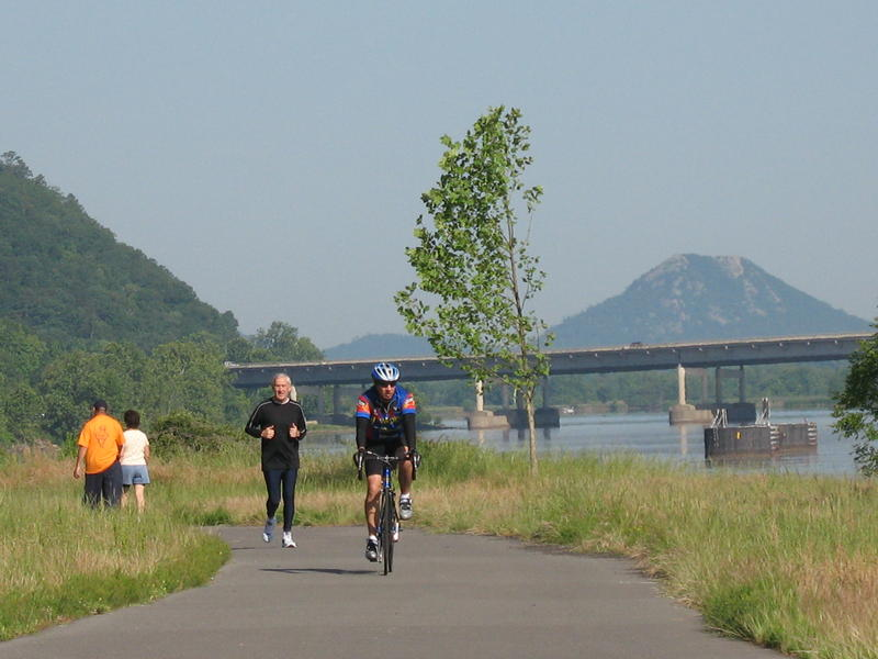 Pinnacle Mountain looms in the background on the Arkansas River Trail.