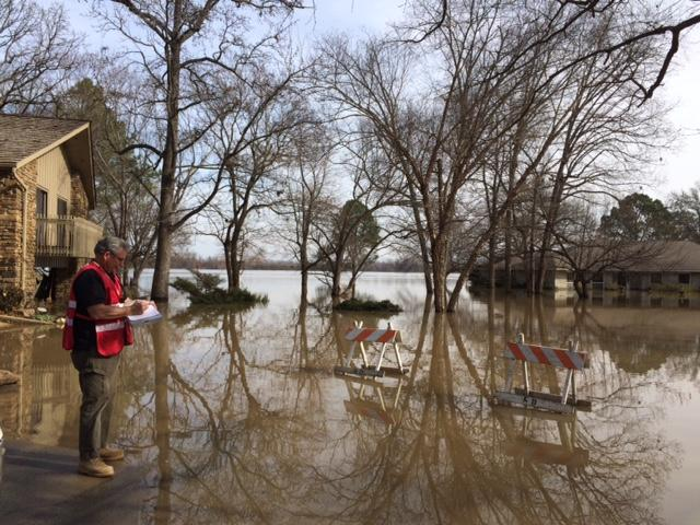 A Red Cross worker assessing flooding near Fort Smith.