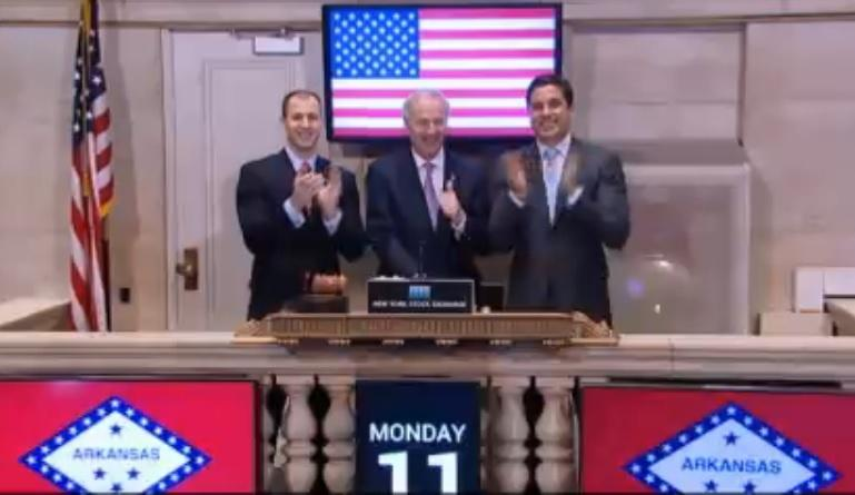 Arkansas Economic Development Commission director Mike Preston (left), Governor Asa Hutchinson (center) at the NYSE.
