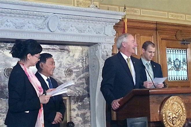 Gov. Asa Hutchinson announcing a $1 billion investment by a Chinese company in a Clark County paper mill.