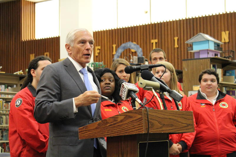 City Year Little Rock founding chair and Hall High graduate Wesley Clark speaking in front of City Year members at Hall High School.