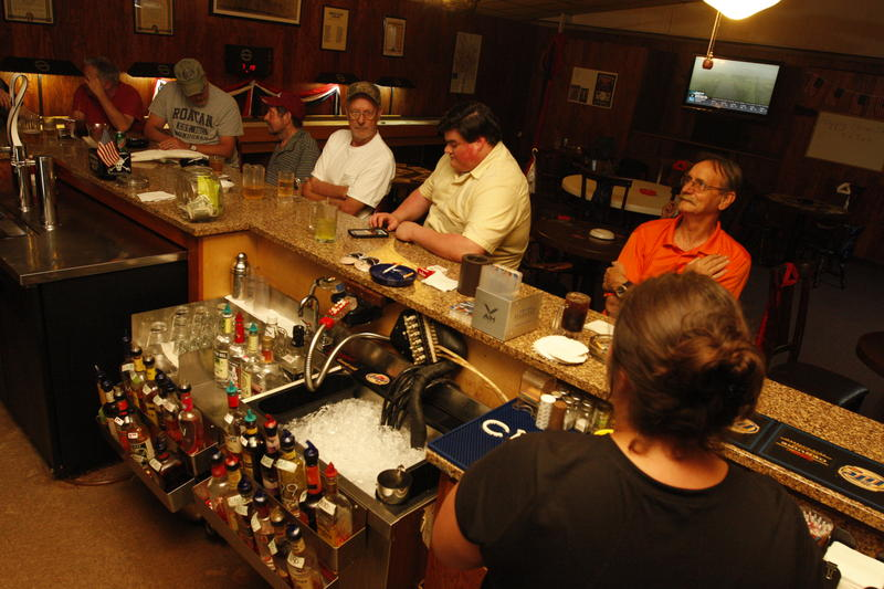 Bartender Jamie Whitehurst takes a break while Shane Griffis (far left), Jimmy Moore, Eddie Barksdale, Josh Griffis and Lynn Wofford belly up to the bar.