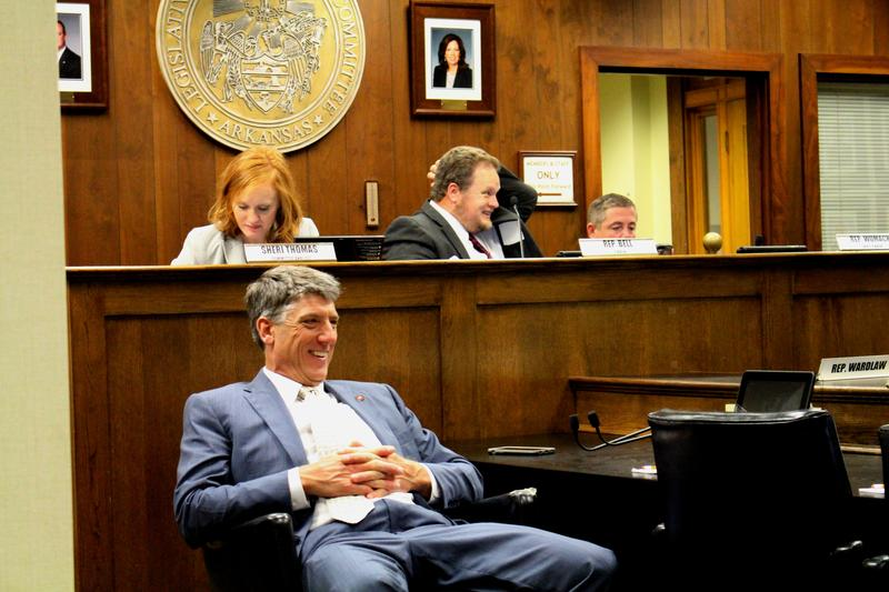 Former Rep. Kelly Linck (R-Flippin) relaxing in a chair (front left) during a committee's last meeting at the close of a special legislative session in May 2016.