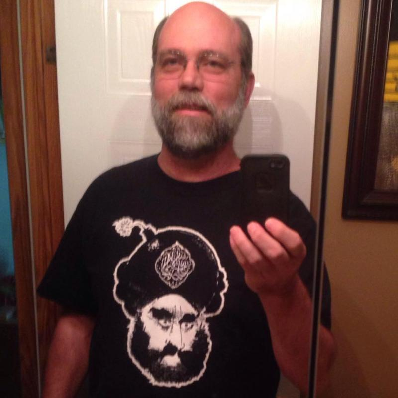 Possible Libertarian State House candidate Rick Bernard wearing a t-shirt depicting a turban as a bomb. The image was drawn by Danish cartoonist Kurt Westergaard.