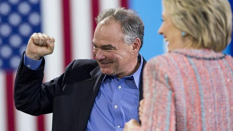 Democratic vice presidential nominee Tim Kaine standing with presidential nominee Hillary Clinton.