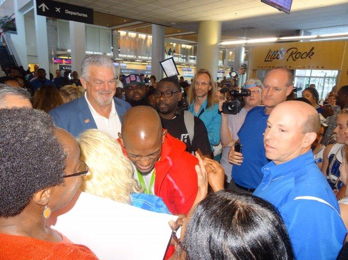 Olympian Jeff Henderson and supporters at Little Rock airport