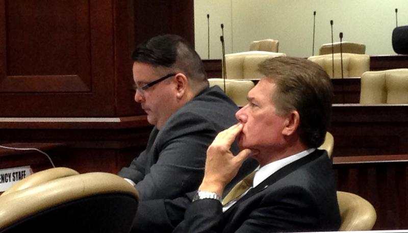 Arkansas Insurance Department Commissioner Alan Kerr (front) and Communications Director K Ryan James at a meeting of the Health Reform Legislative Task Force.