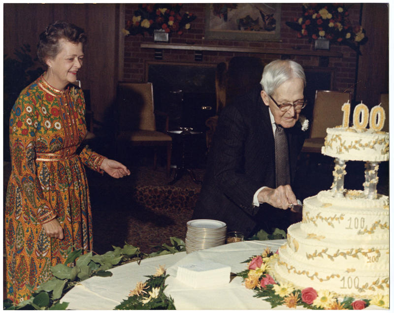 J.N. Heiskell cuts the cake at his 100th birthday celebration in 1972