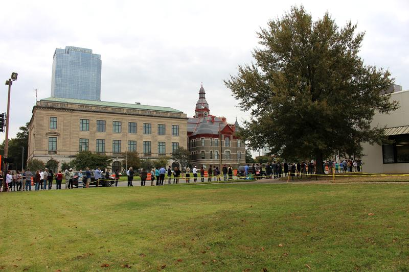 Two lines wrapped around the Pulaski County Regional Building on the last day of early voting before noon. The Pulaski County Courthouse is in the background.