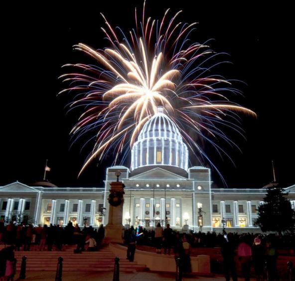 Arkansas State Capitol with Christmas lights and fireworks