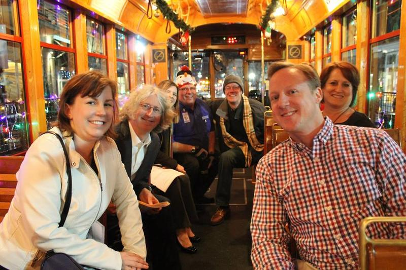Participants in Arts & Letters' trolley episode pose for a photo.