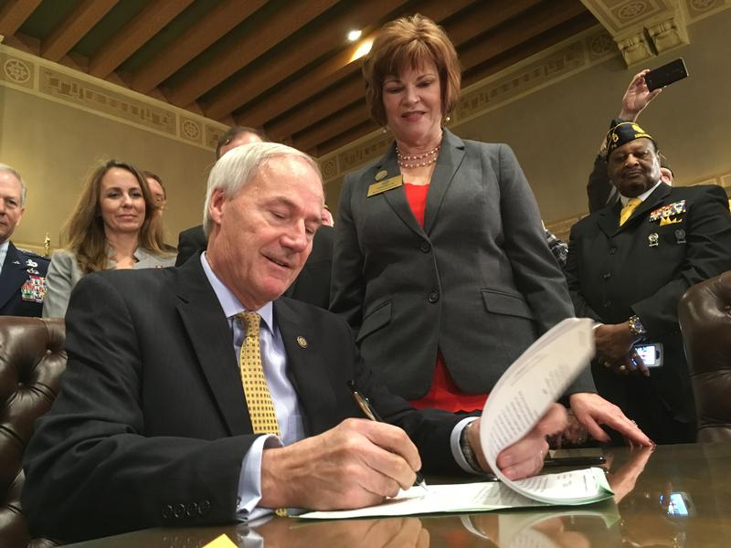 Governor Asa Hutchinson sign into law Military retirees tax break