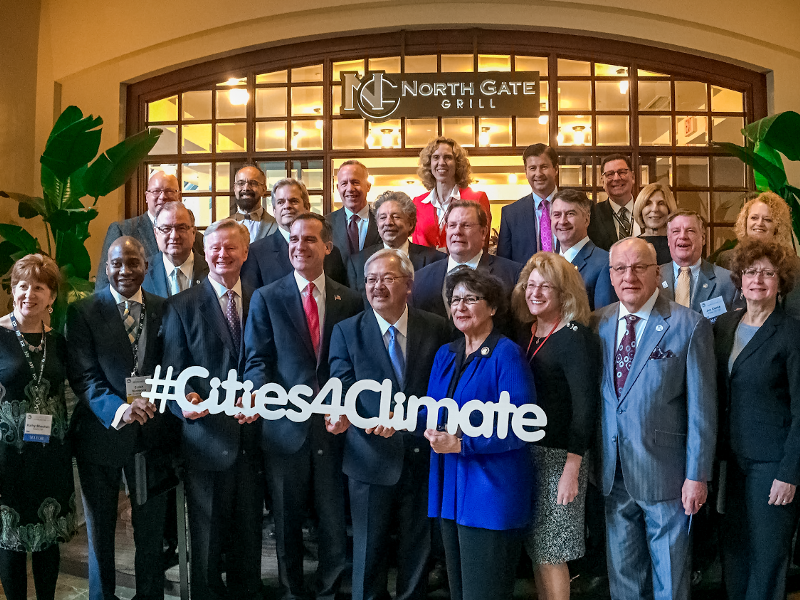 Little Rock Mayor Mark Stodola joins other members of the National Climate Action Agenda