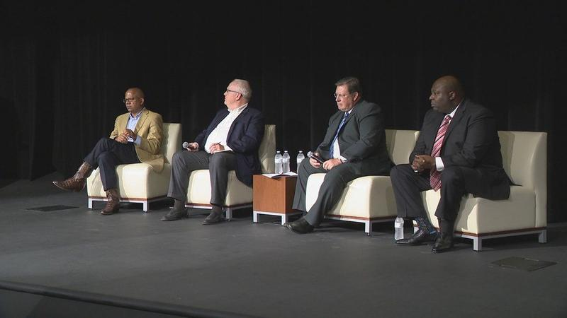 "Panelists (left to right) City Manager Bruce Moore, Moderator Rex Nelson, Mayor Mark Stodola and Police Chief Kenton Buckner take part in ""Crime in Little Rock... a Dialogue"" at the Ron Robinson Theater."