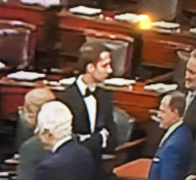U.S. Senator Tom Cotton (R) voting on the Senate floor wearing a tuxedo.