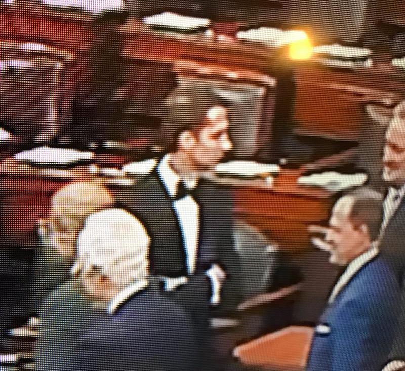 U.S. Senator Tom Cotton (R) voting on the Senate floor wearing a tuxedo.