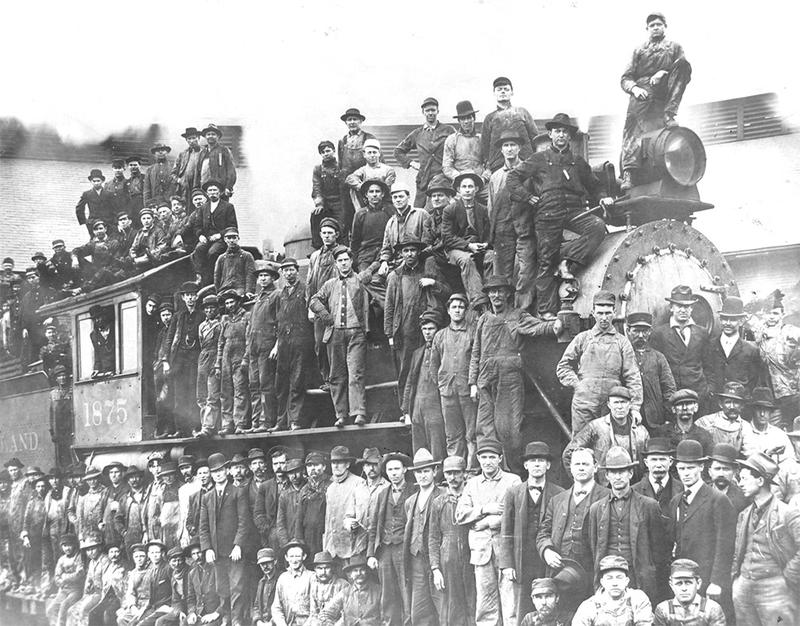 Employees crowd onto a Rock Island locomotive in North Little Rock in 1904, shortly after the takeover of the Choctaw, Oklahoma & Gulf was completed.