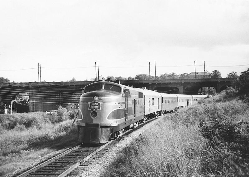 The Rock Island's streamlined Choctaw Rocket is eastbound in 1949, passing under the Third Street overpass in Little Rock.